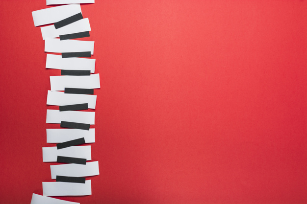 piano-keys-made-with-black-white-paper-red-backdrop_23-2147926849